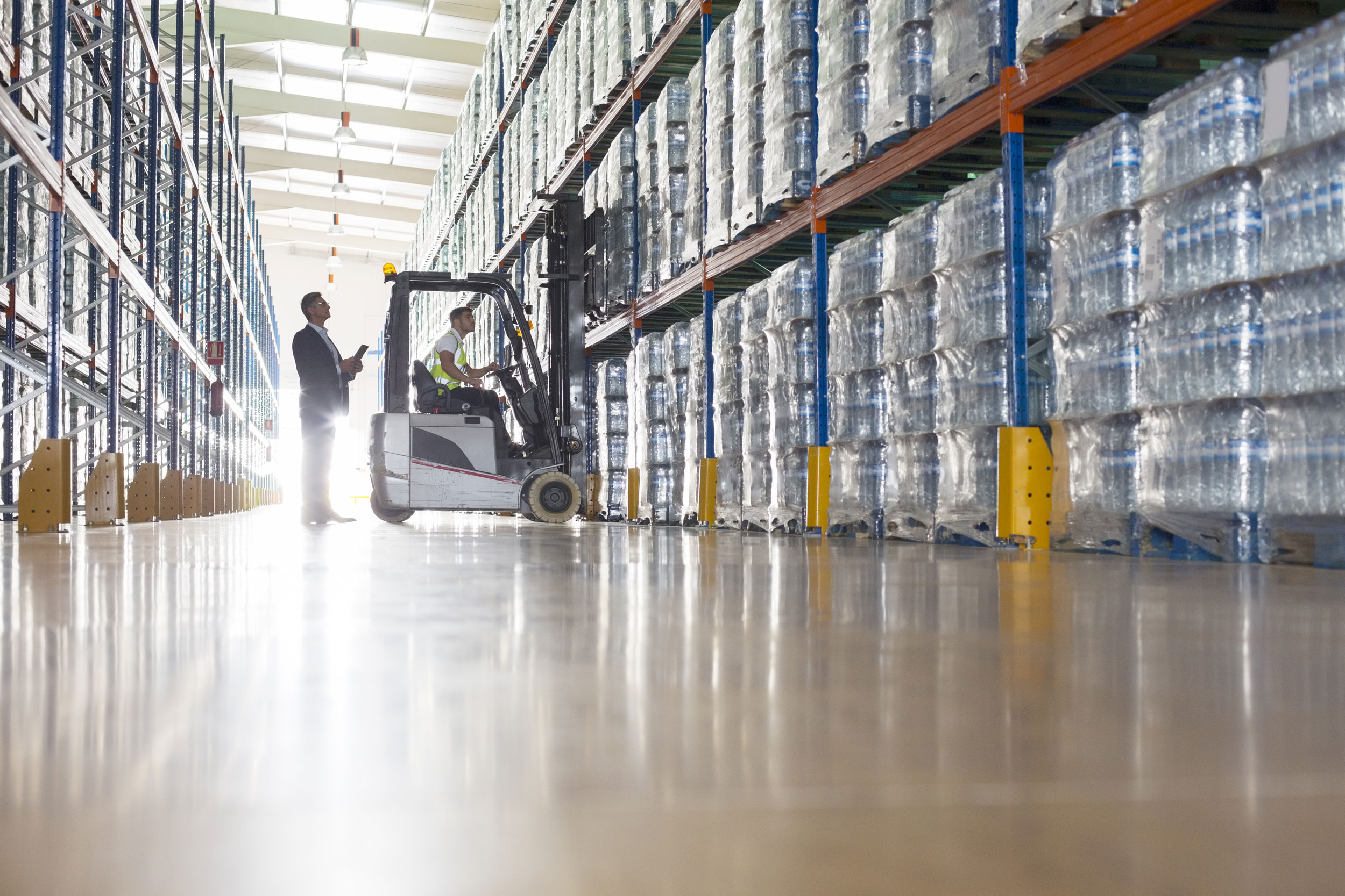 European Steel Manufacturers Sales And Distribution Companies Mail: Img-erp-org-workers-with-forklift-in-bottling-warehouse