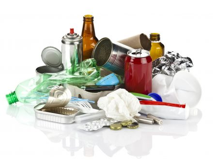 Photo of Large group of polluting waste against white background